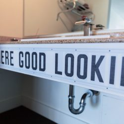 Rambler: bathroom sink with Hey There Good Looking text