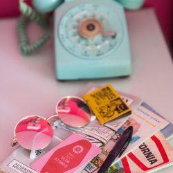Rambler: teal telephone, sunglasses, keycard and California maps