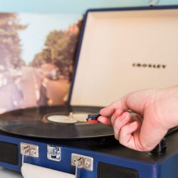 Rambler: record player with hand putting the needle on