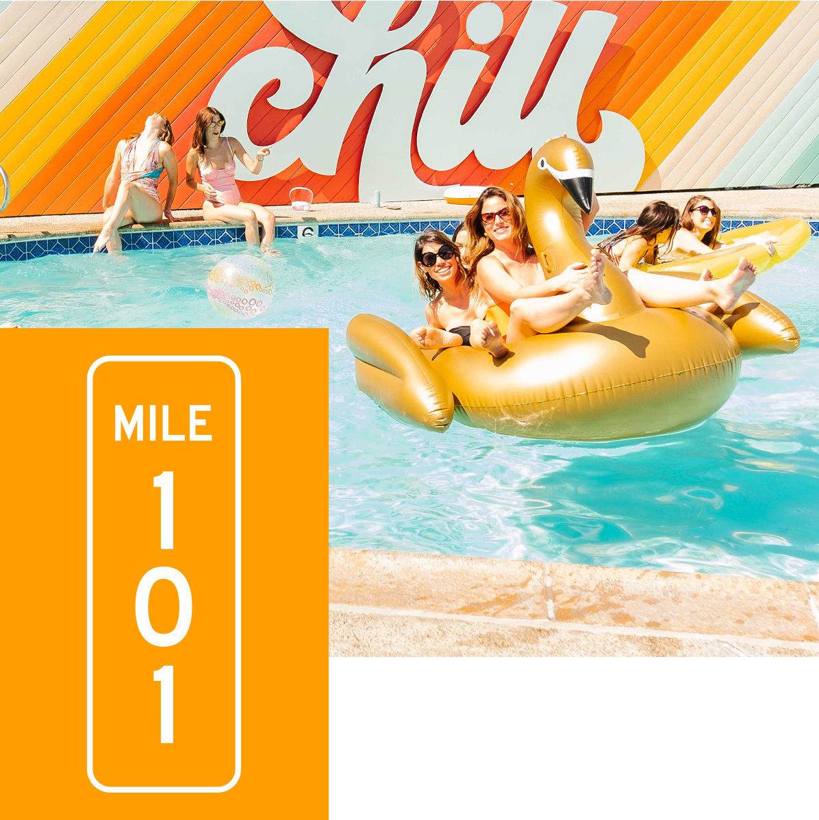 Girls hanging out in the pool and by the CHILL artwork sign. Mile Marker 101 displayed.