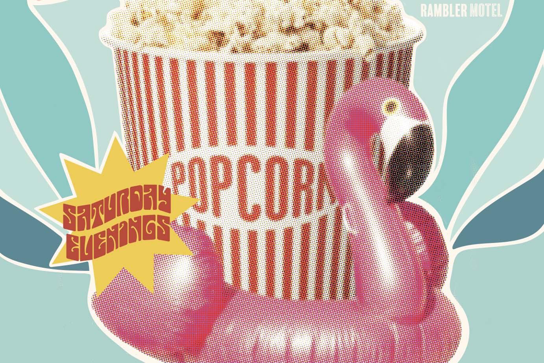 Flamingo raft holding a bucket of movie theatre popcorn