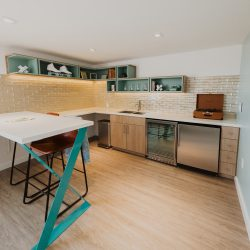 Kitchen in Rambler suite with mini fridge and bar counter